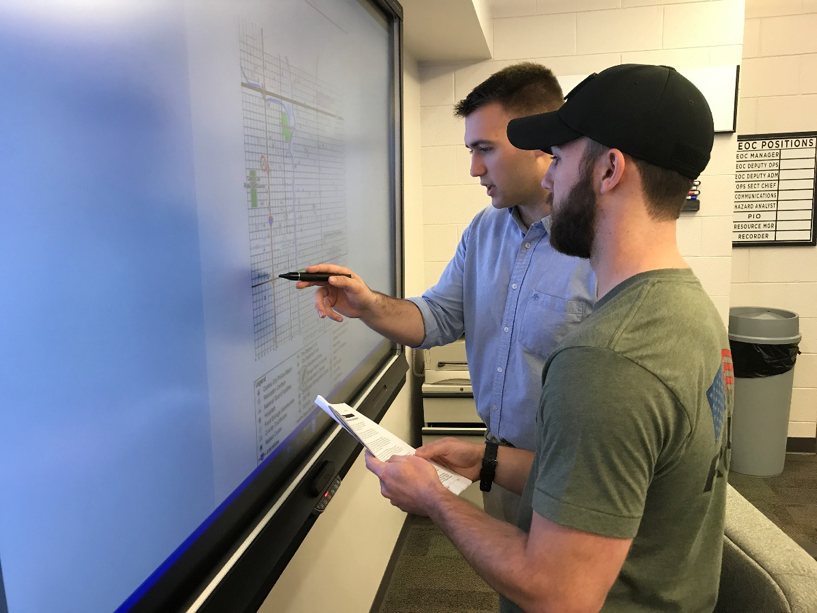 In the photo above, students Jonathan Ehret and Chase Worthington are using a map of Central City and reported damages to craft initial response measures. The Madison County Emergency Operations Center provides state-of-the-art technologies to support planning for all phases of emergency management.